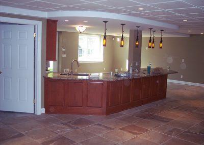 Pittsford, NY – Basement Renovation adding Bedroom, Kitchen, Home Theater and Custom Bath